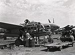 The Mechanics Working on an Engine (BOND 0289).jpg