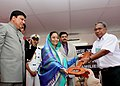The President, Smt. Pratibha Devisingh Patil handing over the key of permanent houses built for the Tsunami victims of Kinyuka village in Car Nicobar Islands, on December 26, 2007.jpg