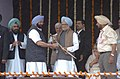 The Prime Minister, Dr. Manmohan Singh receiving a Saropa from the Chief Minister of Punjab Capt. Amarinder Singh in Amritsar, Punjab on March 24, 2006.jpg