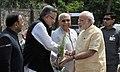 The Prime Minister, Shri Narendra Modi being welcomed by the Governor of Chhattisgarh, Shri Balramji Das Tandon and the Chief Minister of Chhattisgarh, Dr. Raman Singh, at Jagdalpur Airport, in Chhattisgarh on May 09, 2015.jpg