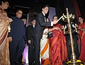 The Super Cinestar Shahrukh Khan lighting the lamp to inaugurate the 42nd International Film Festival of India (IFFI-2011), at Ravindra Bhavan, in Madgaon, Goa on November, 23.jpg