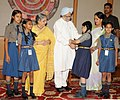 The school children tying 'Rakhi' to the Prime Minister, Dr. Manmohan Singh, on the occasion of 'Raksha Bandhan', in New Delhi on August 13, 2011. Smt. Gursharan Kaur is also seen (3).jpg