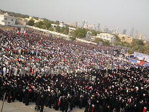 "Aftermath of the Bahraini uprising (July–December 2011) - Thousands of demonstrators gather for ""National demands: An elected government"" rally in Karrana, Bahrain on 8 July."