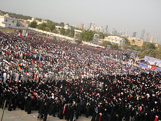 """Aftermath of the Bahraini uprising (July–December 2011) - Thousands of demonstrators gather for """"National demands: An elected government"""" rally in Karrana, Bahrain on 8 July."""