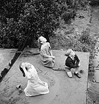 Three children watch aircraft pass over their garden in 1944. D20623.jpg