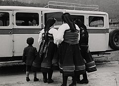 Three women and a child in front of a bus NMFF 002574 26b.jpg