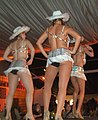 Three women table dancing during a party (4197469166).jpg