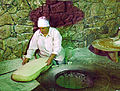 Traditional lavash bread making (5211763362).jpg