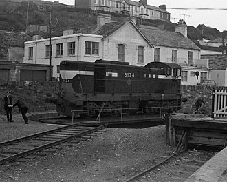 Youghal railway station - After working a freight train from Cork, one of CIÉ's 121 class diesel locomotives is turned on the turntable at the east end of Youghal station in March 1975