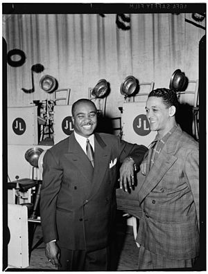 Trummy Young - Trummy Young (right) and Jimmie Lunceford, early 1940s.  Photograph by William P. Gottlieb.