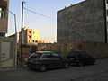 Two car parked near wall - near amin al-Islami garden 2.JPG
