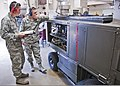 U.S. Air Force Airman Michael Hoy, left, and Senior Airman Joseph Szymanski, both with the 361st Training Squadron, check their instruction manual for a gas turbine generator to troubleshoot an electrical 110608-F-NS900-015.jpg
