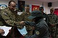 U.S. Air Force Gen. Philip Breedlove, left, the NATO Supreme Allied Commander Europe, presents a female Afghan National Police (ANP) recruit with a certificate of completion for a basic patrolman's course as 140109-Z-TF878-842.jpg