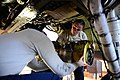 U.S. Air Force Staff Sgts. Eddie Santana, left, and AnnMarie Ringer, both crew chiefs with the 510th Aircraft Maintenance Unit, install a jet fuel starter on an F-16 Fighting Falcon aircraft May 13, 2013 130513-F-AI558-074.jpg