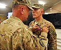 U.S. Army Maj. Gen. Kurt Stein, left, the commander of the 1st Theater Sustainment Command, presents Col. Ron Novack, the commander of the 3rd Sustainment Brigade, with a Bronze Star during a ceremony before 130826-A-CE832-023.jpg