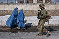 U.S. Army Staff Sgt. Guy Cooper walks by two Afghan women while performing a presence patrol through the snow-covered streets of Gardez, Paktia province, Afghanistan, Feb 120216-A-ZU930-001.jpg