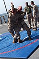 U.S. Marine Corps Lance Cpl. Branden Cooper, right, and 1st Lt. Jordan Miller, with Security Cooperation Task Force Africa Partnership Station (APS) 2012, practice Marine Corps Martial Arts Program techniques on 120804-M-JU449-165.jpg