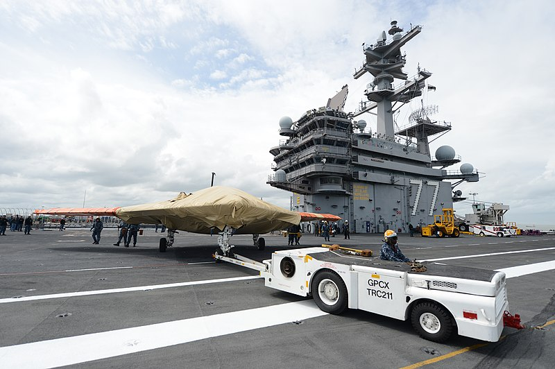 File:U.S. Navy Aviation Boatswain's Mate (Equipment) 3rd Class Audley Campbell moves a Navy X-47B Unmanned Combat Air System demonstrator aircraft on the flight deck of the aircraft carrier USS George H.W. Bush (CVN 130506-N-FU443-373.jpg