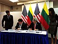 U.S. Secretary of State John Kerry and Lithuanian Foreign Affairs Minister Linas Linkevičius sign an agreement to advance protection against nuclear and radiological smuggling in Brussels, Belgium, on April 23, 2013.jpg