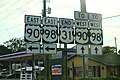 US31 South End - US90 US98 East West Signs (43233453071).jpg