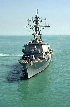 USS Carney - A grey warship in murky water