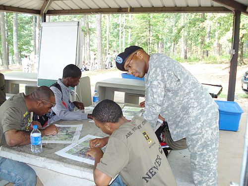 An army trainer mentors new soldiers.