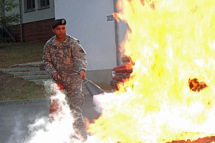 Use of a CO 2 fire extinguisher. US Army 53023 Fire Prevention Week.jpg