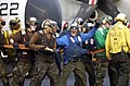 US Navy 021212-N-4142G-024 hose team during crash, rescue, and firefighting drills.jpg