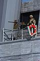 US Navy 030115-N-5319A-005 A soldier stands watch with a .50 caliber machine gun.jpg