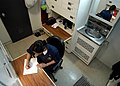 US Navy 030208-N-4048T-153 Lt.j.g. Karen Sankes takes time to write a letter in her stateroom.jpg