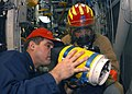 US Navy 031021-N-8955H-003 Sailors are training on how to use the Naval Firefighting Thermal Imager (NFTI) during a General Quarters training drill aboard USS Blue Ridge (LCC 19).jpg