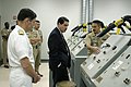 US Navy 031024-N-4204E-022 Senior Chief Aviation Ordnanceman Jeffery A. Grosso shows the Honorable William A. Navas Jr. a wiring training station used to teacher recruits necessary wiring used in naval weapons.jpg