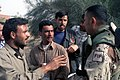 US Navy 033003-M-2176J-031 A Free Iraqi Force (FIF) person talks to the Iraqi citizens of Umm Qasr while in support of Operation Iraqi Freedom.jpg