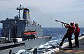 US Navy 040528-N-8148A-016 Torpedoman's Mate 3rd Class Jaime Valdez, of Boulder, Colo., shoots a leader line between USS Ronald Reagan (CVN 76) and the Military Sealift Command.jpg