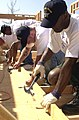 US Navy 040623-N-8977L-009 Sailors assigned to Nimitz-class aircraft carrier USS Ronald Reagan (CVN 76) construct wall framing while helping the non-profit group Habitat for Humanity build homes.jpg