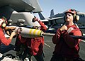 US Navy 040907-N-9293K-033 Aviation Ordnancemen load a 500lb. Mk-82 general purpose bomb on an F-A-18E Super Hornet aboard the Nimitz-class aircraft carrier USS Abraham Lincoln (CVN 72).jpg