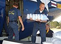 US Navy 040922-N-7559C-066 Aviation Maintenance Administrationman 1st Class Brian Harvey of Atlanta, Ga., unloads ice from Fat Albert.jpg