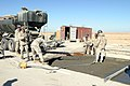 US Navy 050113-M-4711R-004 U.S. Navy Seabees repair part of the runway at Al Asad Air Base in Iraq, to improve airfield capabilities.jpg