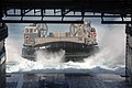 US Navy 060126-N-4374S-006 A Landing Craft, Air Cushion (LCAC), assigned to Assault Craft Unit Four (ACU-4), approaches the well deck of dock landing ship USS Carter Hall (LSD 50).jpg