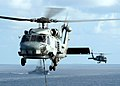US Navy 060413-N-9079D-941 An SH-60B Seahawk helicopter assigned to the Saberhawks Helicopter Squadron Light Four Seven (HSL-47), carries supplies onto USS Abraham Lincoln (CVN 72).jpg