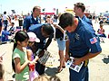 US Navy 060514-N-8374E-003 Members of the Blue Angels enlisted team autograph memorabilia for enthusiastic young fans.jpg