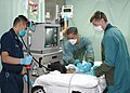 US Navy 060830-N-9076B-188 Lt. Cmdr. Todd Sheer, right, Hospital Corpsman 3rd Class Bryan Duong, left) and Hospitalman Shannon Dawkins, prepare to perform an endoscopies on a patient in casualty receiving on the Military Sealif.jpg