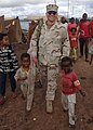 US Navy 061202-F-4925S-055 U.S. Navy Lt. Cmdr. Jeff Weitz walks holding hands with two children who live in a tent city set up by Combined Joint Task Force-Horn of Africa (CJTF-HOA) after a severe flooding in Dire Dawa, Ethiopi.jpg