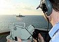 US Navy 070226-N-6710M-011 Quartermaster Seaman David B. Heismann takes bearings as dock landing ship USS Tortuga (LSD 46) passes through the busy waterways of Okinawa, Japan.jpg