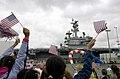 US Navy 070420-N-7130B-274 Families and friends cheer as USS Ronald Reagan (CVN 76) return home from deployment.jpg