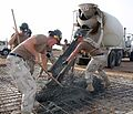 US Navy 070515-N-0938M-005 Seabees attached to Naval Mobile Construction Battalion (NMCB) 133 pour concrete into a concrete pad located inside the expansion area of Camp Lemonier.jpg