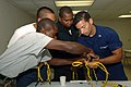 US Navy 070621-N-0989H-052 BM1 Ernest Ramos assists members of the Belize National Coast Guard, Belize Police Force, and the Belize Defense Force with line splicing during coxswain training aboard High Speed Vessel (HSV) 2 Swif.jpg