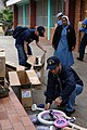US Navy 070705-N-8861F-012 Chief Personnel Specialist Edward Lopez, assigned to dock landing ship USS Pearl Harbor (LSD 52), and other Sailors of Task Group 40.0 conduct a community relations project and distribute Project Hand.jpg