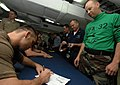 US Navy 070713-N-8923M-164 Ultimate Fighting Championship (UFC) fighter Rich Franklin signs his name for a Sailor during an autograph session on the mess decks aboard Nimitz-class aircraft carrier USS Harry S. Truman (CVN 75).jpg