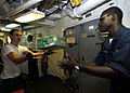 US Navy 070909-N-0841E-376 Sailors aboard guided-missile frigate USS Carr (FFG 52) help store supplies during a vertical replenishment with Military Sealift Command fleet replenishment oiler USNS Tippecanoe (T-AO 199).jpg